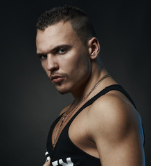 Portrait of  strong man on a black background