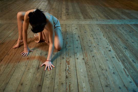 girl crawling on the floor in  ballroom