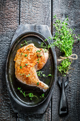 Piece of chicken with fresh marjoram