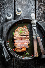 Hot beef with rosemary and papper on plate