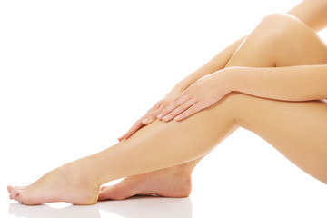 Spa woman sensual touching her leg.