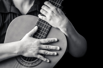 Musician hands playing a classic guitar