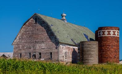 weathered barn, silos, cornfield