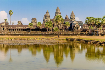 Angkor Wat seen across the lake, reflected in water