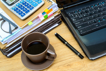 stack of folders and documents with coffee