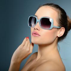 Beautiful girl with sun glasses. Sexy woman. Fashion girl.
