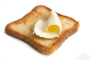 butter on a slice of toasted bread