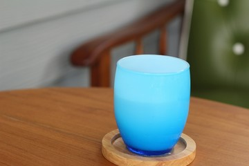 Blue glass of water on table