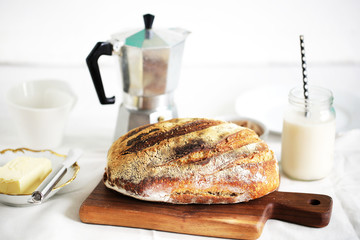 Rustic wholegrain sourdough loaf, butter, almond milk, coffee