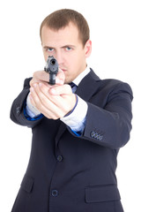 serious man in business suit aiming gun isolated on white