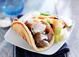 gyro with greek salad and tzatziki sauce