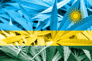 Rwanda Flag on cannabis background. Drug policy.