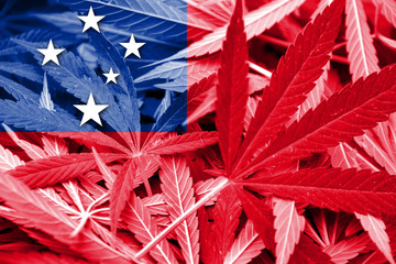 Samoa Flag on cannabis background. Drug policy.