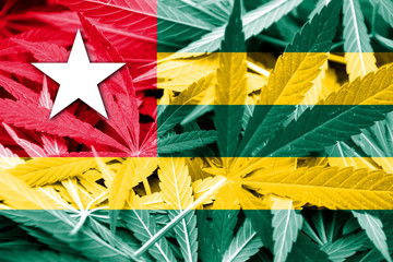 Togo Flag on cannabis background. Drug policy.