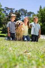 Happy siblings with their dog