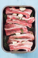 Seasoned Raw Spareribs with Rosemary and Thyme in Baking Form