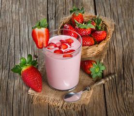 yogurt with fresh strawberries in a glass
