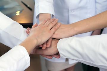 United hands of medical team close up