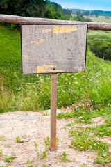 Empty old wooden sign with place for text