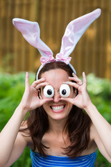 Woman Wearing Bunny Ears and Silly Egg Eyes