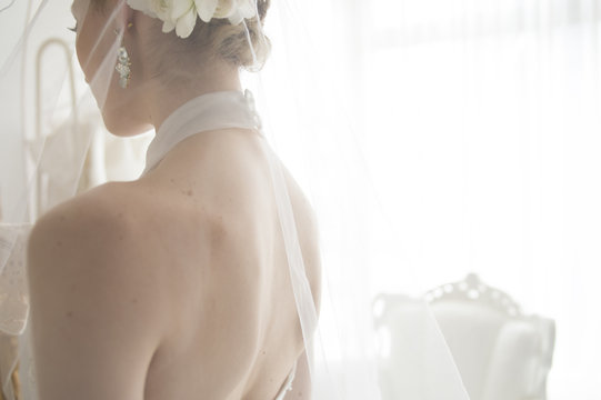 From behind the bride