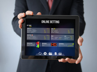 businessman with bet online tablet