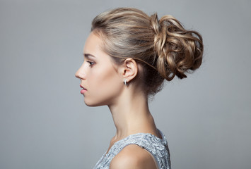 Wall Mural - Beautiful Blond Woman. Hairstyle and Make-up.