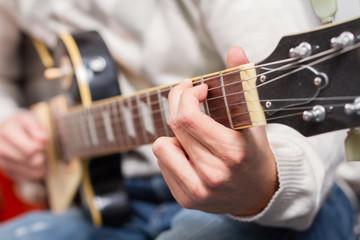Closeup hand of man playing electric guitar