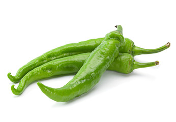 Green chilli pepper on white