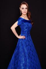 Beautiful elegant lady in blue dress