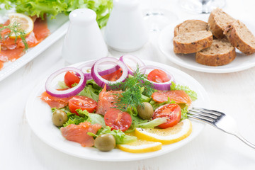 salad with salted salmon on a plate
