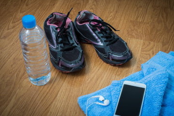 Sport equipment. Sneakers, water , earphones, smart phone