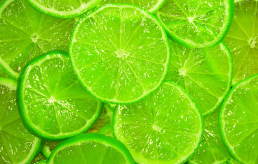 juicy green slices of lime background