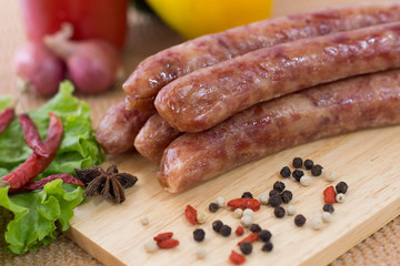 chinese sausages on chopping block