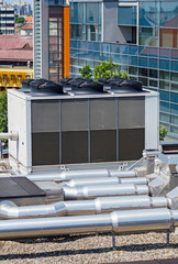 Large air conditioners on the roof of an office building
