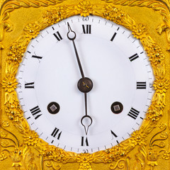 Ancient ornamental golden clock face