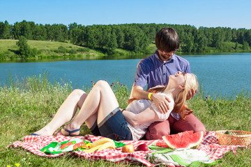 Couple in love at a picnic at the lake