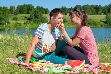 Young boy and girl on a picnic by the lake