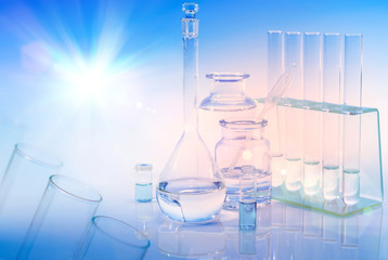 Scientific background with chemical glass, flask and tubes