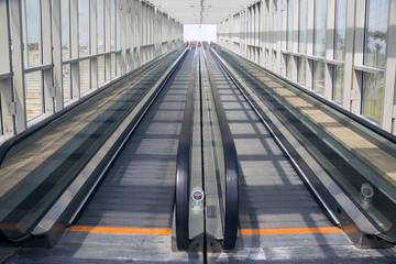 Tape escalator in glazed tunnel