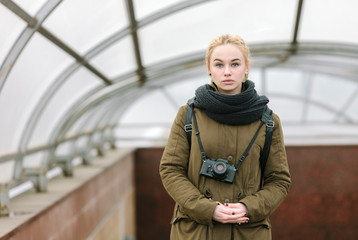 Outdoors city portrait young blonde hipster woman photographer
