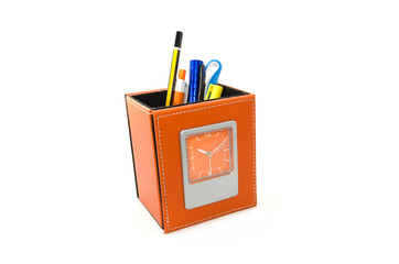 orange stationery compartment with clock on white background