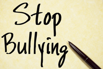 stop bullying text write on paper