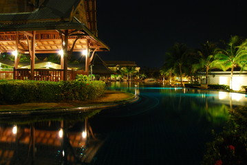 night scene of swimming pool in thailand