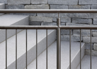 Nobles Edelstahlgeländer und  graue Granittreppe im Außenbereich