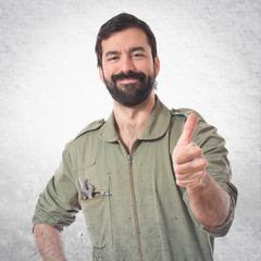 Mechanic with thumb up