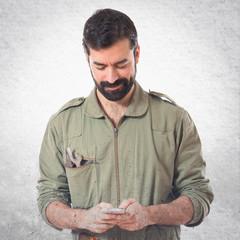 Happy mechanic talking to mobile