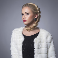 Beautiful blond young woman in fur