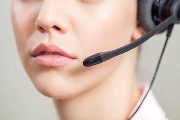 Closeup Of Customer Service Representative Wearing Headset