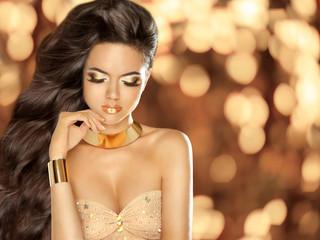 Fashion Beautiful girl with Long Wavy Hair wearing in golden jew